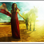 Red haired lady in red and her white stallion at dawn in the desert