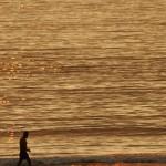 Playa América ocaso sol dorado