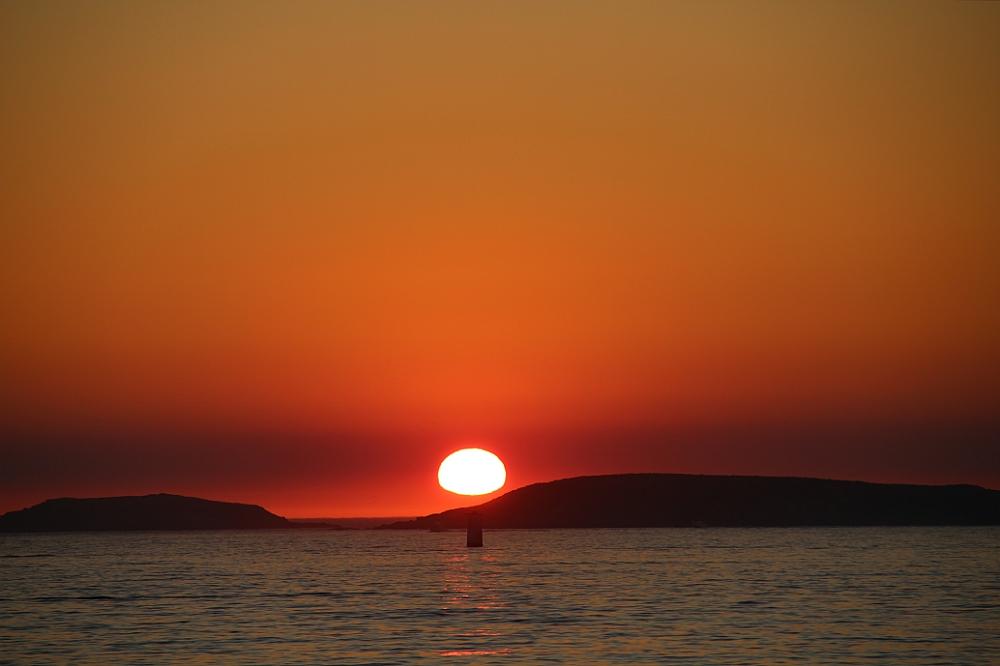 Atardecer rojo en Playa América Nigrán autor Manuel Ramallo