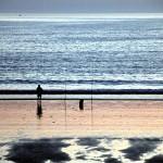 Pescando al atardecer en playa América Panxón