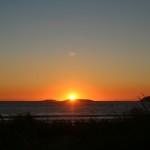 Sol rojo en atardecer en Playa América autor Manuel Ramallo
