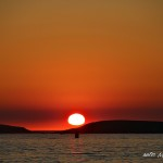 Atardecer con sol rojo de verano en playa América Nigrán Pontevedra